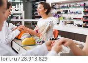 Купить «Manicure masters working», фото № 28913829, снято 28 апреля 2017 г. (c) Яков Филимонов / Фотобанк Лори