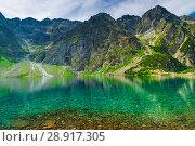 Купить «background - scenic landscape of a mountain and a lake in the Tatra Mountains, Poland», фото № 28917305, снято 18 августа 2017 г. (c) Константин Лабунский / Фотобанк Лори