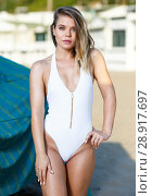 Купить «Closeup of young female in swimsuit posing near hotel», фото № 28917697, снято 10 июля 2018 г. (c) Яков Филимонов / Фотобанк Лори