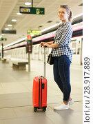 Купить «Woman with suitcase at subway station», фото № 28917889, снято 27 апреля 2018 г. (c) Яков Филимонов / Фотобанк Лори