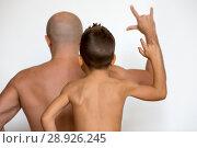 Купить «Father and son show muscles», фото № 28926245, снято 4 октября 2014 г. (c) Ekaterina Demidova / Фотобанк Лори