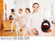 Купить «Positive active young female fencer standing at fencing workout», фото № 28926365, снято 11 июля 2018 г. (c) Яков Филимонов / Фотобанк Лори