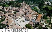 Купить «Aerial view of historic centre of Besalu with Romanesque bridge over Fluvia river, Catalonia, Spain», видеоролик № 28936161, снято 23 июня 2018 г. (c) Яков Филимонов / Фотобанк Лори