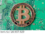 Купить «Golden bitcoin on a computer motherboard. Cryptocurrency virtual», фото № 28937929, снято 13 августа 2018 г. (c) Алексей Букреев / Фотобанк Лори