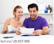 Купить «Happy man and woman reading mail together at home», фото № 28937985, снято 10 июля 2020 г. (c) Яков Филимонов / Фотобанк Лори