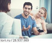 Купить «Young couple with real estate agent at home», фото № 28937989, снято 18 января 2020 г. (c) Яков Филимонов / Фотобанк Лори