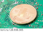Купить «Golden litecoin on a computer motherboard. Cryptocurrency virtual», фото № 28938305, снято 13 августа 2018 г. (c) Алексей Букреев / Фотобанк Лори