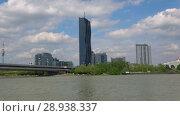 """Купить «Вид на """"DC Tower"""" - самое высокое здание Вены. Австрия», видеоролик № 28938337, снято 28 апреля 2018 г. (c) Виктор Карасев / Фотобанк Лори"""