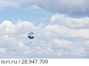 Berlin, Germany, captive balloon with advertising for the daily Die Welt am Himmel (2017 год). Редакционное фото, агентство Caro Photoagency / Фотобанк Лори