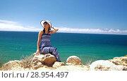 Купить «Woman at the beach enjoying her vacation», видеоролик № 28954497, снято 9 августа 2018 г. (c) Илья Шаматура / Фотобанк Лори