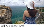 Купить «Woman enjoying her vacation», видеоролик № 28954549, снято 9 августа 2018 г. (c) Илья Шаматура / Фотобанк Лори