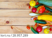 Купить «Multicolored fresh raw vegetables: cucumbers, tomatoes, onions, sweet pepper and young zucchini lie on the right on wooden background. Top view. Free space for text», фото № 28957289, снято 24 июля 2018 г. (c) Виктория Катьянова / Фотобанк Лори