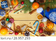 Купить «Merry Christmas and a Happy New Year. Bright congratulatory background with space for text in the center. Top view. Xmas still life», фото № 28957293, снято 25 июля 2018 г. (c) Виктория Катьянова / Фотобанк Лори