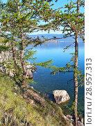 Купить «Summer sunny morning on the shore of Lake Baikal. Beautiful Olkhon Island coast with green larches and blue water of Small Sea Strait», фото № 28957313, снято 8 августа 2018 г. (c) Виктория Катьянова / Фотобанк Лори