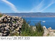 Купить «Lake Baikal. Cape Khorgoy is famous for the ruins of the ancient Kurykan stone wall one of the remarkable archeological monuments on Olkhon Island», фото № 28957333, снято 9 августа 2018 г. (c) Виктория Катьянова / Фотобанк Лори