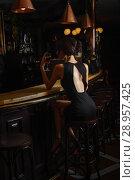 Купить «elegant lady in black dress, in restaurant at a bar», фото № 28957425, снято 19 июля 2018 г. (c) Restyler Viacheslav / Фотобанк Лори