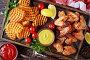 Купить «fried chicken wings, Crispy Potato fries», фото № 28957497, снято 31 июля 2018 г. (c) Oksana Zh / Фотобанк Лори
