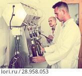 Купить «worker with bottling machinery», фото № 28958053, снято 16 августа 2018 г. (c) Яков Филимонов / Фотобанк Лори