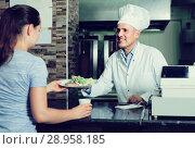 Купить «man cook serving fresh kebab dish to customer on counter in fas», фото № 28958185, снято 15 октября 2018 г. (c) Яков Филимонов / Фотобанк Лори