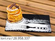 Купить «Pancakes served chocolate, walnut and powdered sugar at plate», фото № 28958337, снято 16 сентября 2019 г. (c) Яков Филимонов / Фотобанк Лори