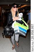 Купить «Heather Locklear at Los Angeles International Airport (LAX) with her little dog Featuring: Heather Locklear Where: Los Angeles, California, United States When: 19 Apr 2017 Credit: WENN.com», фото № 28958997, снято 19 апреля 2017 г. (c) age Fotostock / Фотобанк Лори