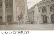 Купить «Happy boys play in fountain near the Gostinniy Dvor in Moscow», видеоролик № 28960729, снято 25 июля 2018 г. (c) Ирина Мойсеева / Фотобанк Лори