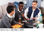 Купить «Males friendly meeting over beer», фото № 28961309, снято 23 февраля 2018 г. (c) Яков Филимонов / Фотобанк Лори