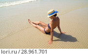 Купить «Summer lifestyle HD video of pretty young suntanned woman in a hat. Enjoying life and sitting on the beach, time to travel. Looking at the sea», видеоролик № 28961701, снято 15 августа 2018 г. (c) Happy Letters / Фотобанк Лори