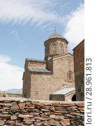 Купить «Tsminda Sameba- Holy Trinity Church near the Kazbegi-Gergeti village.The Church is situated at an altitude of 2170 meters at the foot of mount Kazbek», фото № 28961813, снято 18 августа 2013 г. (c) Олег Хархан / Фотобанк Лори