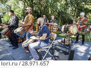 Купить «Florida, Micanopy, Fall Harvest Festival, annual small town community event, booths stalls vendors buying selling, all White playing African drum circle music, stage, musical performance,», фото № 28971657, снято 28 октября 2017 г. (c) age Fotostock / Фотобанк Лори