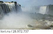 Купить «Cataratas del Iguazu Waterfall on Iguazu River in National Park, Parana, Brazil», видеоролик № 28972737, снято 22 марта 2017 г. (c) Яков Филимонов / Фотобанк Лори