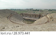 Купить «Amphitheatre in ancient city Hierapolis. Pamukkale, Turkey», видеоролик № 28973441, снято 21 марта 2019 г. (c) Данил Руденко / Фотобанк Лори