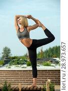 Купить «Beautiful girl doing yoga out-of-doors shot», фото № 28973657, снято 2 июля 2018 г. (c) Гурьянов Андрей / Фотобанк Лори