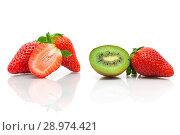 Купить «Juicy kiwi and strawberries on a white background», фото № 28974421, снято 19 мая 2014 г. (c) Ласточкин Евгений / Фотобанк Лори