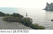 Купить «Woman practice yoga on nature», видеоролик № 28974553, снято 19 июля 2018 г. (c) Илья Шаматура / Фотобанк Лори