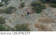 Купить «Woman hiking with backpack», видеоролик № 28974577, снято 19 июля 2018 г. (c) Илья Шаматура / Фотобанк Лори