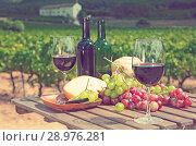 Купить «Red wine, cheese, bread and grapes», фото № 28976281, снято 25 мая 2019 г. (c) Яков Филимонов / Фотобанк Лори