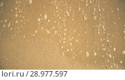 Купить «Sandy sea shore washed by waves high angle video», видеоролик № 28977597, снято 6 августа 2018 г. (c) Гурьянов Андрей / Фотобанк Лори