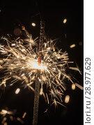 Купить «Abstract sparks from fireworks», фото № 28977629, снято 1 января 2018 г. (c) Argument / Фотобанк Лори