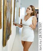 Купить «Woman visiting painting exhibition», фото № 28978597, снято 28 июля 2018 г. (c) Яков Филимонов / Фотобанк Лори