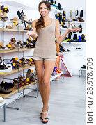 Купить «Female customer showing desired shoe in boutique», фото № 28978709, снято 20 сентября 2018 г. (c) Яков Филимонов / Фотобанк Лори