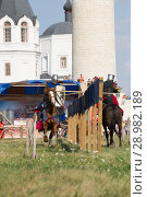 Купить «Bulgar, Russian Federation - August 2018, - performance of men in knight costumes on horseback in front of the audience at the festival of the middle ages», фото № 28982189, снято 11 августа 2018 г. (c) Константин Шишкин / Фотобанк Лори