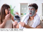 The handsome applying clay mask on face. Стоковое фото, фотограф Elnur / Фотобанк Лори