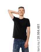 Купить «young teenager in black t-shirt and jeans smiles», фото № 28984481, снято 3 января 2018 г. (c) Restyler Viacheslav / Фотобанк Лори
