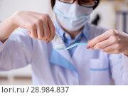 The woman dentist practicing work on tooth model. Стоковое фото, фотограф Elnur / Фотобанк Лори
