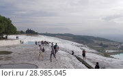 Купить «Tourists visiting travertine terraces in Pamukkale, Turkey», видеоролик № 28985045, снято 13 ноября 2017 г. (c) Данил Руденко / Фотобанк Лори