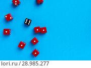 Купить «Red and black gaming dices on blue background», фото № 28985277, снято 3 января 2018 г. (c) Pavel Biryukov / Фотобанк Лори