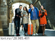 Купить «Two couples reading city map», фото № 28985401, снято 26 июня 2019 г. (c) Яков Филимонов / Фотобанк Лори