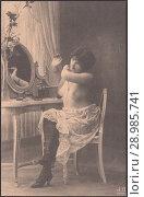 Купить «Полуобнажённая молодая девушка у туалетного столика с зеркалом. Старинная дореволюционная открытка», иллюстрация № 28985741 (c) александр афанасьев / Фотобанк Лори
