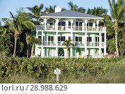 Купить «Florida, Anna Maria Island, Holmes Beach, house home rental, beachfront, balcony, architecture, porch, wraparound balcony, exterior,», фото № 28988629, снято 13 декабря 2017 г. (c) age Fotostock / Фотобанк Лори